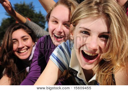 crowd of crazy teen girls celebrating a famous star on the red carpet