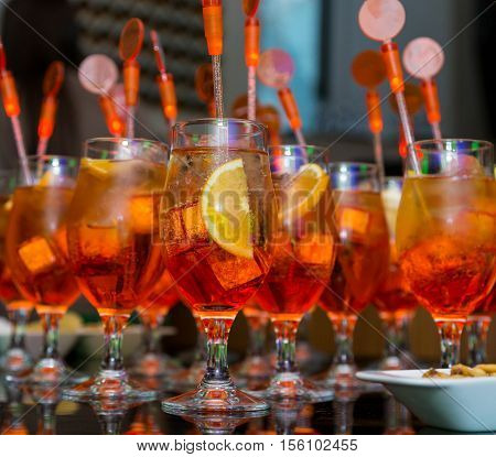 Many Orange Cocktails On Night Party