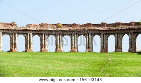 the ruins picture ancient fortress of the 16th century, situated in the village of Ruzhany Grodno region, Belarus, ruined arch against a blue sky
