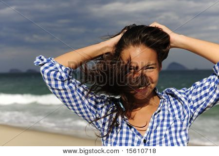 stormy wind: wind blowing young woman?s hair by the sea