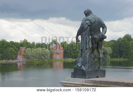 SAINT PETERSBURG, RUSSIA - JULY 10, 2015: The sculpture of Hercules on the background Big pond and the Admiralty. The historical landmark of the Tsarskoye Selo