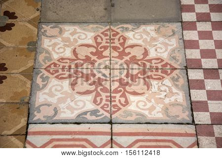 Photo of several floor tiles with several colours and sunlight