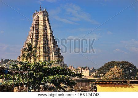 Virupaksha Temple located in the ruins of ancient city Vijayanagar at Hampi India. View from Hampi.