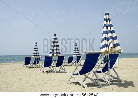 The beach-chairs are ready tot take a sunbath