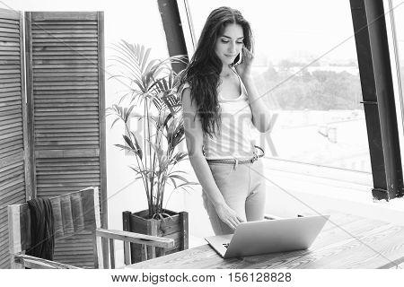 Businesswoman In Office Working With Laptop. Indoor Shot.