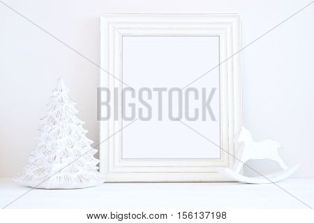 Christmas styled mockup portrait frame christmas tree and rocking horse overlay your business message promotion headline or design great for lifestyle bloggers and social media campaigns