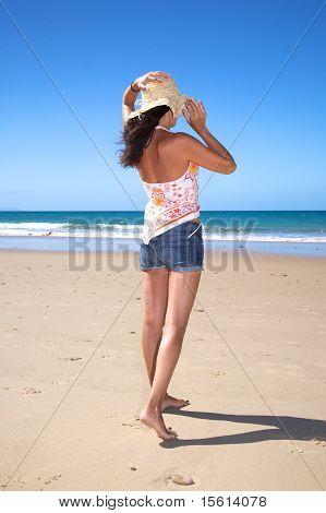 Taking Straw Hat At Beach