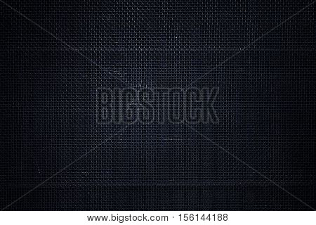 Rough textured black metal mesh photo background
