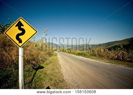 Caution traffic sign on the highway road at northern of Thailand