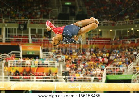RIO DE JANEIRO, BRAZIL AUGUST 7, 2016: Olympic champion Simone Biles of United States competing on the balance beam at women's all-around gymnastics qualification at Rio 2016 Olympic Games