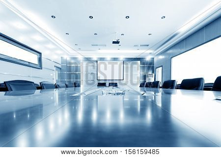 Luxurious meeting room with tables and chairs blue tones.
