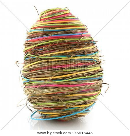 colored straw easter eggs isolated over white
