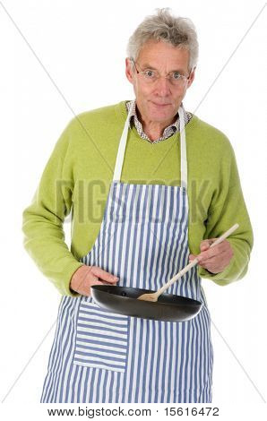 Senior man is cooking in the kitchen