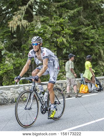 Col du Tourmalet France - July 24 2014: The French cyclist Arnaud Gerard of Team Bretagne-Seche Environnement climbing the difficult road to Col du Tourmalet in Pyrenees Mountains during the stage 18 of Le Tour de France 2014.