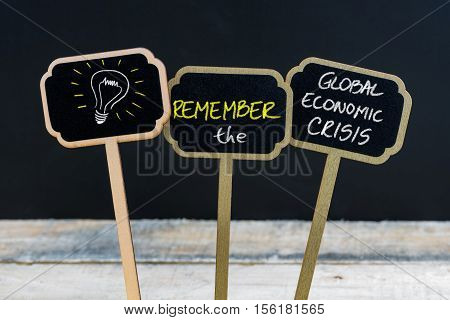 Concept Message Remember The Global Economic Crisis And Light Bulb As Symbol For Idea