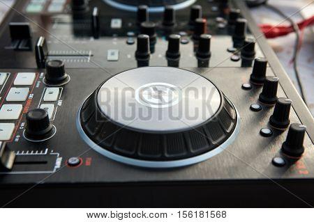 Black dj mixer controller. Close up view.