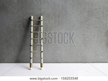 Pencil Ladder Leaning Against Grunge Wall With Copy Space. Success Or Education Concept.