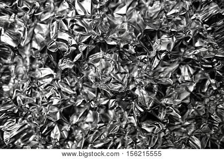 wrinkled texture metallic silver surface with curves