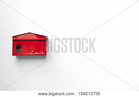 Red mailbox with white background for text space