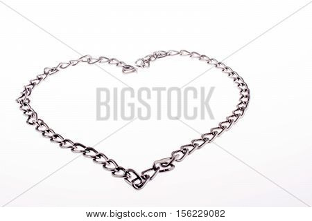 Chain form a heart shape and the word LOVE on grass