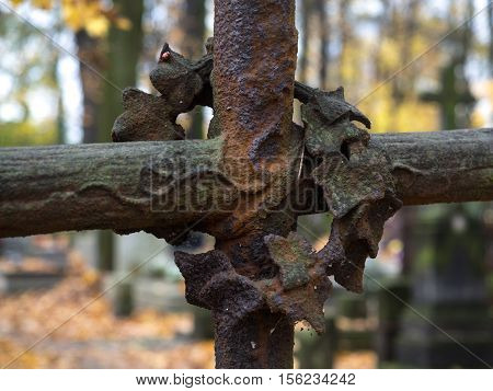 Rusty cross on orthodox cementary necropolis Warsaw