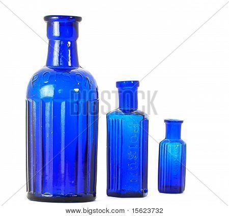 A trio of antique poison bottles