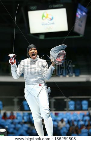 RIO DE JANEIRO, BRAZIL - AUGUST 8, 2016: Ibtihaj Muhammad of the United States celebrates victory in the Women's individual sabre of the Rio 2016 Olympic Games at the Carioca Arena 3