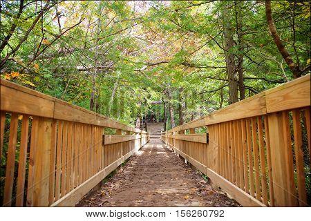 Woodland trail and bridge through Hocking Hills State Park near Logan Ohio