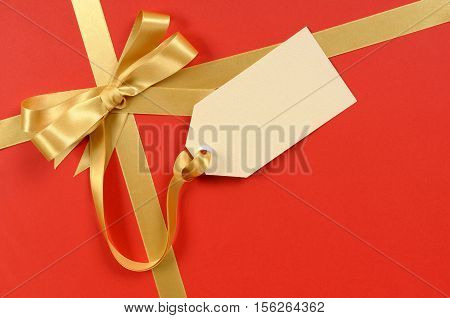 Red Gift Background, Gold Ribbon Bow, Blank Gift Tag Or Label, Copy Space