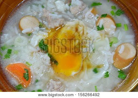 boiled rice with pork sausage topping creamy yolk on bowl