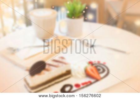 de-focused tiramisu dessert on table in coffee time