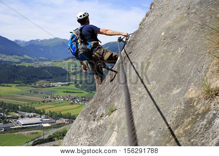 sport climbing man on a rock wall in the alps