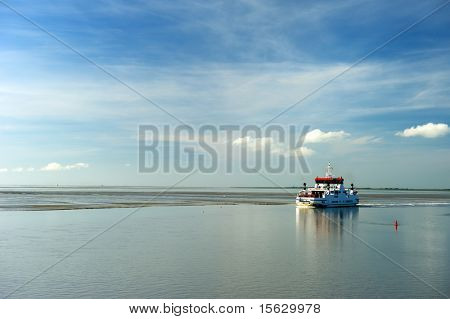 Ferry boat at wadden sea during ebb tidal