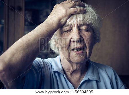 Elderly woman with a headache