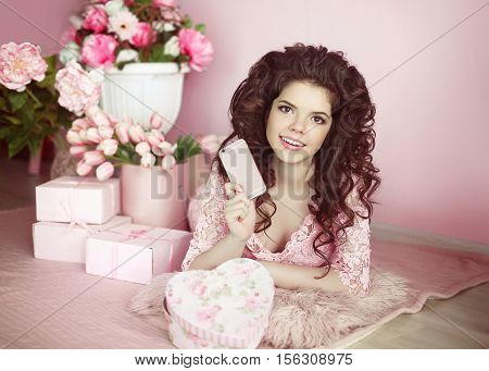 Beautiful Young Teen Girl Holding Mobile Phone. Brunette With Flowers Bouquet And Gift Boxes In Pink