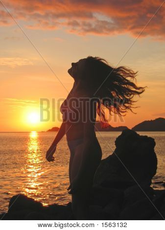 A Woman In Profile Moving Her Head On Her Long Hair At The Sunset, Labuan Bajo, Pede Beach, Flores I