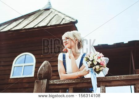 Young girl in on a veranda of wooden russian house
