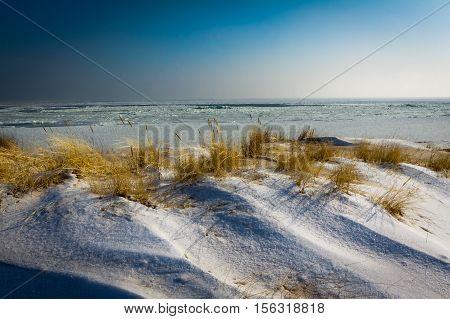 Winter sunrise in frosen beach, Poland, Baltic Sea