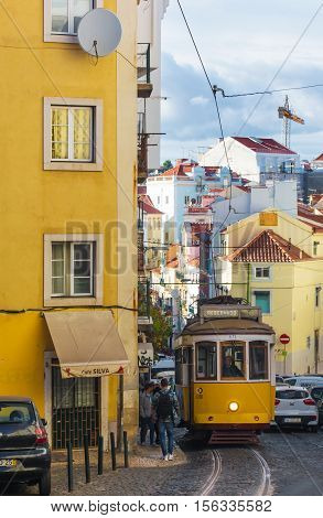 LISBON PORTUGAL - OCTOBER 13 2014. old yellow tram on the street