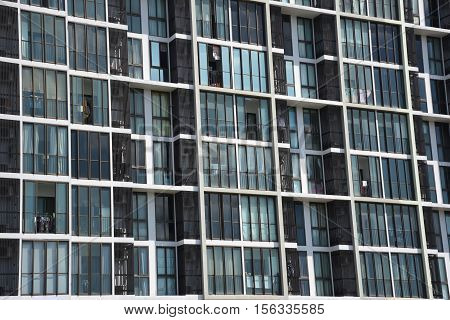 Building Background : Condo windows and balconies viewed.