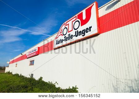 BURG / GERMANY - NOVEMBER 13 2016: A.T.U sign at shop. A.T.U is a large car repair shop chain and retailer for car components with ca. 600 branches in Germany Austria and Switzerland.