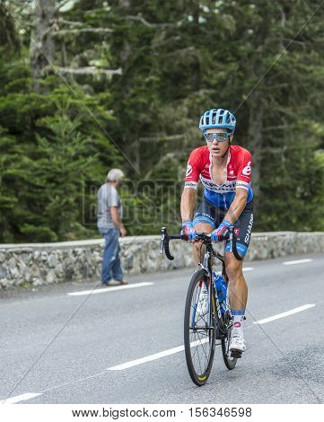 Col du Tourmalet France - July 242014: The Dutch cyclist Sebastian Langeveld of Garmin-Sharp Team climbing the difficult road to Col du Tourmalet in Pyrenees Mountains during the stage 18 of Le Tour de France 2014.