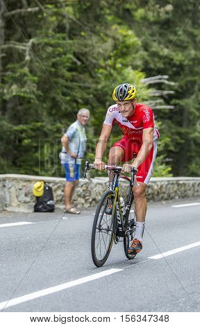 Col du Tourmalet France - July 242014: The French cyclist Adrien Petit of Cofidis Team climbing the difficult road to Col du Tourmalet in Pyrenees Mountains during the stage 18 of Le Tour de France 2014.