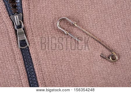 Safety Pin On Clothes As A Symbol Of Solidarity
