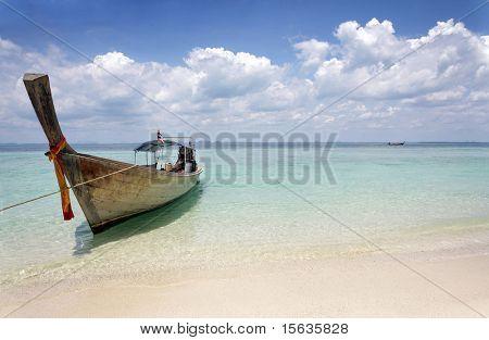 beautiful longtail boat on the sand seashore