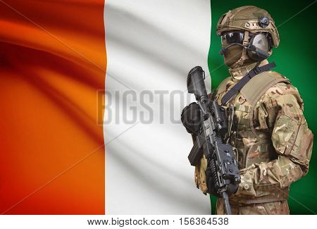 Soldier In Helmet Holding Machine Gun With Flag On Background Series - Ivory Coast - Cote D'ivoire