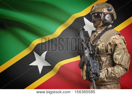 Soldier In Helmet Holding Machine Gun With Flag On Background Series - Saint Kitts And Nevis