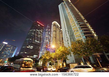 SHANGHAI - NOV 5, 2015: High buildings at dark night, Shanghai has population of 24,6 millions people
