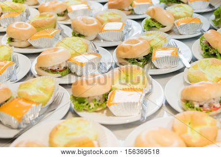 Mini tuna burgers with orange cake. Coffee break set.