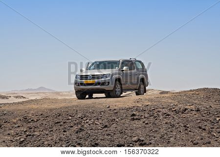 SWAKOPMUND, NAMIBIA - NOVEMBER 27, 2015: VW off-road vehicle in the moon landscape near Swakopmund, Namibia